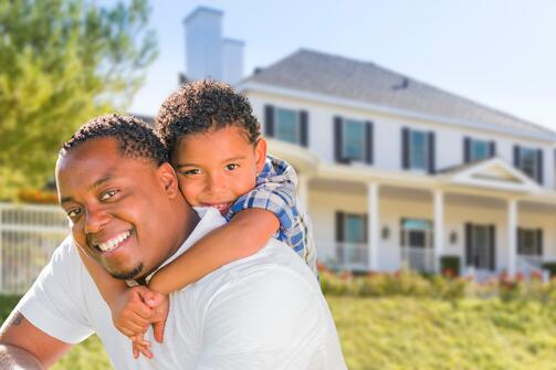 Father_and_Son_Happy_with_New_Home_in_Summertime.jpg