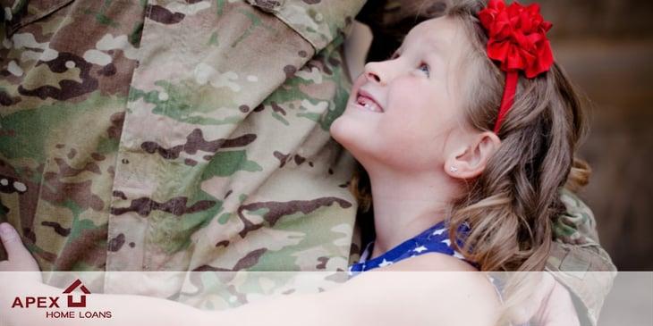 child hugging soldier