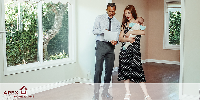 Young interracial couple with baby touring a home